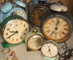 Old clocks can be strewn down the center of a long rectangular table for an Alice in Wonderland theme party or wedding. Go to tag sales, craigslist, amazon, etsy and more to find.