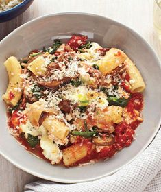 Baked Spinach and Mushroom Rigatoni - There's no need to precook the rigatoni—the tomato sauce and vegetables render the pasta soft, tender, and saturated with juicy flavor. Works well with penne pasta also.
