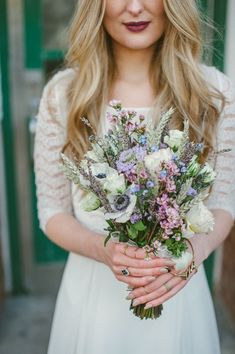 anemone and wildflower bouquet, photo by Ellie Gillard http://ruffledblog.com/bohemian-london-wedding #flowers #weddingbouquet #weddingbouquets