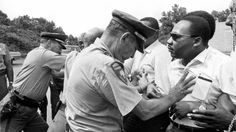Mississippi patrolmen shove King during the 220-mile March Against Fear from Memphis, Tennessee