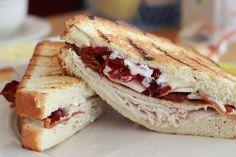 sliced turkey, cranberry, bacon, brie