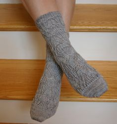 Grey and lace...sure way to this knitter's heart..Ravelry: Soo Sock pattern by Kitman Figueroa