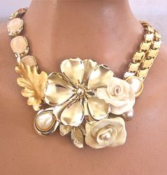 I like the use of two different necklaces as the base for this necklace. Just a few brooches and you have something really pretty.