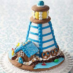 Gingerbread isn't just for Christmas; it's fun all year round! This very cool gingerbread lighthouse is reminiscent of vacations at the shore and brings a nautical touch to your celebrations. A great gift for a sea-worthy friend. Pre-assembled.