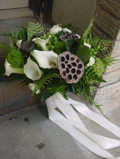 Green, brown and white bouquet of ferns, callas and brown lotus pods by Limelight Floral Design Hoboken NJ