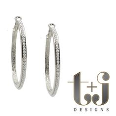 """Large t+j Designs Pearl Hoop Earrings Trendy meets classic with these silver plated, perfect pearl-studded hoops. The omega back is easy to wear and makes sure they don't slip off.  Approximately 1.75"""" diameter. The exterior diameter is closer to 2"""".  Comes with a jewelry pouch. T&J Designs Jewelry Earrings"""