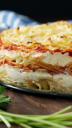 Because spaghetti pie was so last season, enjoy it now in cake form with layers of pasta, bolognese, mozzarella, ricotta and more.