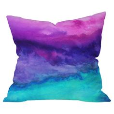 Bring a pop of color to your sofa or favorite arm chair with this chic pillow, showcasing a watercolor-inspired motif.