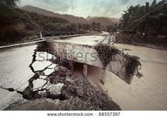 Damaged concrete bridge over tropical river in mountain. Consequences of flood.