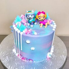 Paw Patrol Sky and Everest Drip Cake from @sakurabakingco on Instagram and Facebook