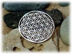 Flower of Life Pendant - Silver - An Excellent Tool for Healing.  The whole universe in one jewel!  The Flower of life pendant is excellent for healing and it helps in connecting you to your higher self.   Where Math, Geometry and Spirituality meet The flower of life shape contains a secret shape known as the fruit of life.  It consists of 13 spheres that hold many mathematical and geometrical laws.
