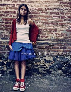 Red #Converse #Chucks Chuck Taylor low-tops; #tennis shoes; #trainers (On the Wall 12 by San Budi, via Flickr)