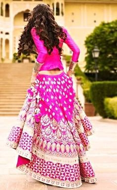 The back. Stunning fuschia lehenga by: Anita Dongre. Love the long sleeves, and her hair! #Want!