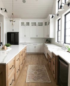 The farmhouse kitchen will never go out of style. Get the look, like this white oak floor with Bona Ultra Matt Finish, with the help of a Bona Certified Craftsman. Photo: Gowler Homes Kitchen Redo, Rustic Kitchen, New Kitchen, Kitchen Pics, White Oak Kitchen, Black Appliances White Cabinets, Two Toned Kitchen, Kitchen With Black Appliances, Natural Wood Kitchen Cabinets