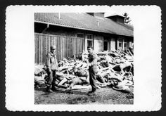 Dachau death camp, Germany, American soldiers next to a pile of corpses, after the liberation.