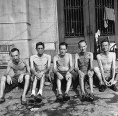 Starving and malnourished men at the liberation of the Santo Tomas internment camp.