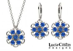 Admirable Jewelry Set: Pendant and Earrings Designed by Lucia Costin with Twisted Lines and Blue Swarovski Crystals, Crafted with 6 Petal Middle Flowers and Dots; .925 Sterling Silver Lucia Costin. $95.00. Produced delicately by hand, made in USA. Romantic floral design. Beautifully designed with deep blue Swarovski crystals. Floral jewelry set by Lucia Costin. Unique and feminine, perfect to wear for special occasions and evenings