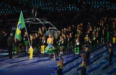 Swimmer Daniel Dias of Brazil carries the flag during the Opening Ceremony of the London 2012 Paralympics at the Olympic Stadium on August 29, 2012 in London, England.