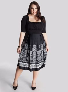 "Isis Plus Size Dress - Dresses by IGIGI Details      Square neck, draped bodice fits smaller to larger busts     Set-in sleeves end at the elbow     Silhouette-cinching 3"" high-waistband     A-line skirt     Fully lined     Invisible side zipper  Color:  Black/Ivory Material:  Poly/Elastane Care:  Dry Clean Only Sku:  3A103CBLK"