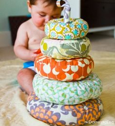 Fabric Ring Stacker  I love the quilt style aesthetic to this bad boy. It may take a while to make, but it'll last, you can toss all the par...