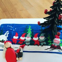 Swedish tomte and Jerry Roupe tablecloth