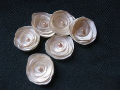 Flowers like these for the bridesmaids hair? Green?  DIY: Little Satin Flowers - Project Wedding