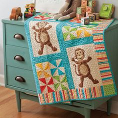 Cute kids quilt. Could use large embroidery designs in place of the monkeys.