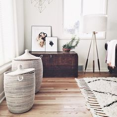 Living room with old trunk and stylish washing baskets