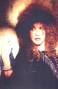 Stevie Nicks totally can pull off this horrible perm.
