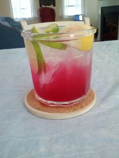 Mix lemonade, grape juice, and vodka. Then put some lemons, limes, and blueberries on top. Such a great summer drink!
