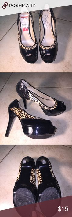 Marc Fisher heels Gently used heels. Probably used once at most but slightly damaged on the inside from being in the closet too long the pictures show it. Size 6. Black and leopard print. With black glitter Marc Fisher Shoes Platforms