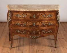 A French Louis XV Style Three Drawer Marquetry Antique Chest of Drawers boasting it's original Sienna Marble top.