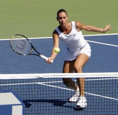 Flavia Pennetta at the 2009 US Open - Flavia Pennetta (born 25 February 1982) is a retired Italian professional tennis player. She became Italy's first top-10 female singles player on 17 August 2009 and the first Italian to be ranked world No. 1 in doubles on 28 February 2011. She is a Grand Slam singles champion, winning the 2015 US Open by defeating Roberta Vinci in the first all-Italian Grand Slam final.