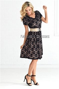 This dress adds a beautiful touch to a must have little black dress. Features black eyelash lace around the neckline and hem. The gorgeous floral black lace is over a cream lining for a strikingly pretty contrast.