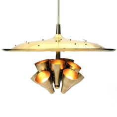 View this item and discover similar for sale at - Spectacular and rare chandelier in lacquered brass having ten perforated up lamps and an embossed dome with modernist flora and fauna and faceted crystal Chandeliers, Faceted Crystal, Hanging Lights, Mid-century Modern, Sconces, 1950s, Mid Century, Brass, Ceiling Lights