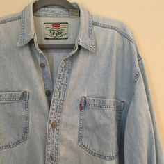 Authentic Levi's Oversized Chambray- Vintage Super soft/ vintage feel & wear. (The collage shows the minimal marks of use.) In overall awesome condition! Don't wear as much as I should to keep. Levi's Tops Button Down Shirts