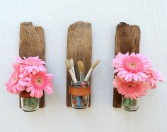 Driftwood vases on the wall