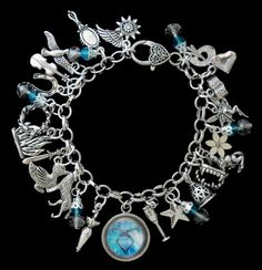 The Mortal Instruments/ The Infernal Devices by RedCrystalDesigns, $17.95 Ok I a officially going to spend all my college fund on jewelry from etsy.
