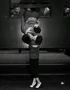 A goodbye kiss between a soldier and his loved one in the 1950s