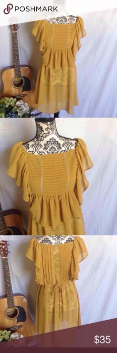 S Line Mustard Pleated Flutter Sleeve Dress S line brand. Sheer. Pleated bodice. Flutter sleeves. Mustard. Ties in back. Need to wear a slip dress beneath. No flaws. Free gift. Size medium Dresses Mini