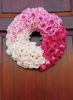 Ombre wreath made of rose petals — a pretty way to spruce up your ceremony or reception venue doors