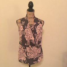 Cute career tank top This tank top is flattering due to how it drapes in the front, pink and brown with flowers. It is a size small and 100% polyester. CAbi Tops Tank Tops
