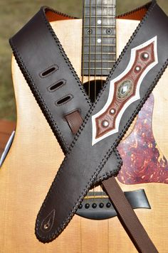 Guitar Players look at this unique leather strap. It sure is nice. Guitar or bass strap western style with oval angel fire concho by VickiDesignsCA
