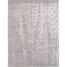 Create a fashion-forward foundation in your living room or master suite with this hand-tufted rug, showcasing an amethyst-hued abstract design. ...