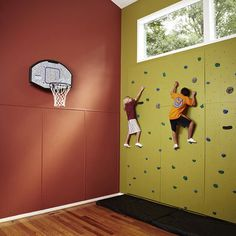 Playroom with rockwall and basketball hoop? Out ceilings aren't tall enough, but if they were if so do this!