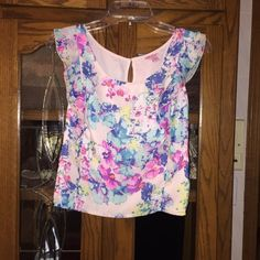 Neon floral sleeveless top Never worn! Adorable neon floral top!  Offers are welcome!!!!  15% discounts on bundles always  I ship orders out FAST!   NO TRADES NO PAYPAY  I ONLY SELL THROUGH POSH!! Candie's Tops