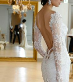 Backless long sleeved wedding dress
