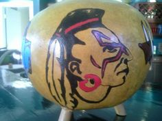 Mohawk, Razorback and Red Wolves cannonball gourd.