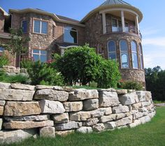 Gorgeous stone retaining wall.