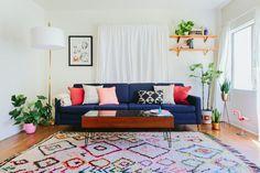 Caroline and Jayden Lee's home on Design*Sponge. Pretty colors and rug, nice plants. A happy room :)